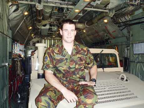 LOGICAL: Flying Officer Dan McCormack on a US Army Humvee inside a 40 Squadron C130 Hercules.PHOTO/SUPPLIED
