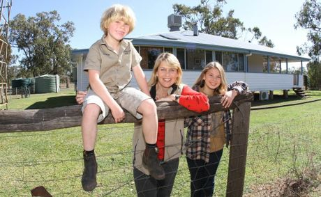 Robert, Terri and Bindi Irwin outside their homestead escape. Photo
