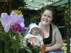 Young Lachlan Elsworth and mum Katherine admire the beautiful garden of Les and Fae Stephson.