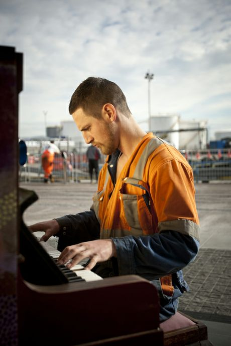 Construction worker Dylan Desmond goes to a public piano at Wynyard Quater each day and plays. 