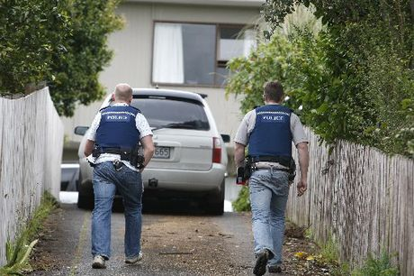 HOT PURSUIT: Police converge on a property in Fairburn St after a high-speed car chase through Whangarei yesterday. PHOTO/JOHN STONE