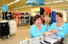 Coles employees Chris Shaw and Gina Scott with the Mix clothing selection, now open to the public.