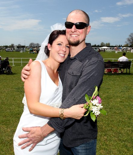 RELIEF: Dave Pink, manager of Firestone Tyres in Napier, won't be needing to work overtime after his fiancee, Lisa Bircham, won a $25,000 wedding package.