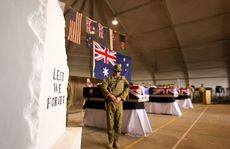 Catafalque Party rests on arms during the memorial service. Australian soldiers and their Afghan coalition partners pay their final respects to their fallen comrades Corporal Ashley Birt, Captain Bryce Duffy and Lance Corporal Luke Gavin at Tarin Kot.
