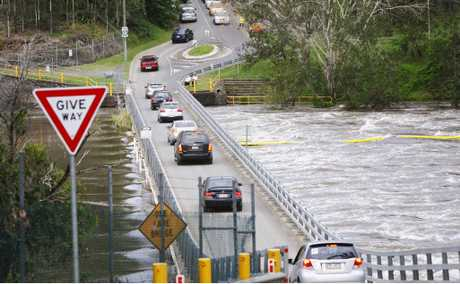 Traffic using the Allawah Rd weir after Colleges Crossing was closed due to flooding.