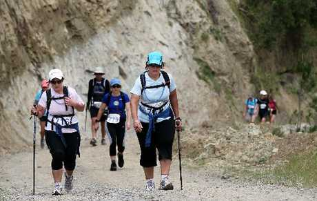 CAPE CRUSADERS: Determined walkers encourage each other as they test themselves on a rugged uphill leg of the challenge. HBT111412-08