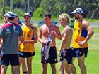 Brisbane Lions player Tom Rockliff (without top) joins team mates as they train at Noosa.