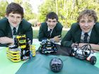 Sunshine Coast Grammar School students Angus Lane, Lokki Brown and Todd Billington are off to Abu Dhabi with their FOOTBALL-playing robot team, The Eliminators, to compete in the World Championships.