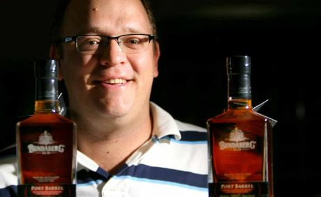 Jason Fagg with two bottles of the new product from Bundaberg Rum.