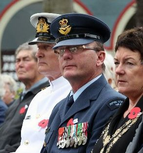 WINGMAN: Wing Commander Bill Blaikie at last Thursday's Armistice Day service in Napier, with the navy's Lieutenant Commander Neville Smith and Mayor Barbara Arnott. PHOTO/DUNCAN BROWN HBT111420-01