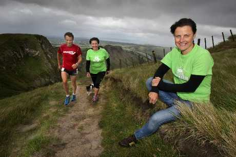 ON COURSE: Champion runner Ross McIntyre (left) joins Peak Trail Blazer organisers Susie Devonshire and Jo Throp as they inspect the course for this Sunday's charity event. PHOTO/WARREN BUCKLANDHBT114247-01
