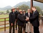Wolgan Valley Resort & Spa general manager Joost Heymeijer hands the Conde Nast Traveler's World Savers Award to Phil Cram, facilities manager and Ben Boothby, senior field guide with the resort's conservation Tteam.