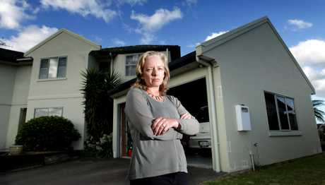 Christine Radford pictured in front of the leaky house.
