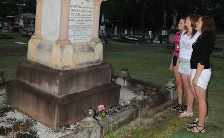 CREEPY AND KOOKY: Alicia Broad, Tara Leslie and Channe Harman visited the Gatton Murders victims memorial during the Gatton Blue Light ghost tour.