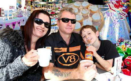 Springfield's Lisa and Tony Power enjoy a coffee with their son Mackenzie, 7, at Robelle parklands (inset) Stalls featured at the Twilight Markets.