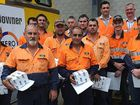 Workers from Downer EDI received awards for their commitment to the company at the Bowen St facility yesterday.