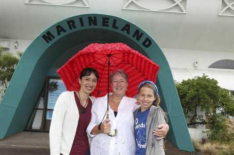 CONFIDENT: Happy the battle for Marineland is set to resume are, from left, Emily Otto, Denise Woodhams and young Marineland Ranger Brianna Otto. PHOTO/DUNCAN BROWN