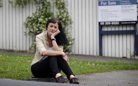 House hunter Vanessa Byrnes outside a property that is for sale in Auckland city. 