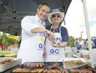 Gold Coast mayoral candidate Tom Tate serves up a sausage to launch his campaign.
