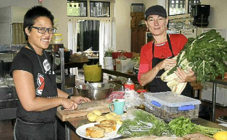 COOKING FOR CHRISTMAS: Rhonda Khong with volunteer Vikki Fraser. Photo Gary Chigwidden