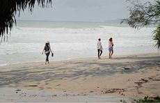 Tourists on Rainbow Beach.