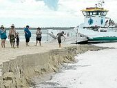 CARS parked at Inskip Point on Tuesday had a lucky escape when they were driven off the beach and onto a barge just minutes before part of the beach gave way.