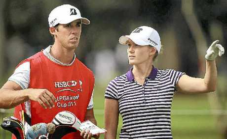 Sarah Jane Smith gets some advice from caddie and husband Duane.