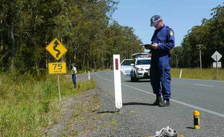 THE driver, who killed two teenage hitch-hikers after crashing into them on New Year's Day near Wauchope has been charged by police.