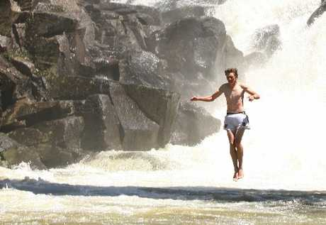 Hazza Elliott leaps from the bridge at McLaren Falls.