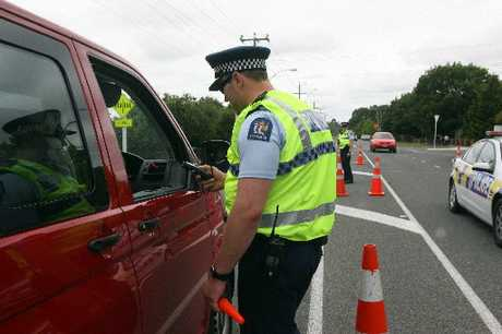 ANYWHERE, ANY TIME: Police, seen here breath-testing a driver, were kept busy