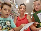 Amanda Budde and her children, Isaac and Hannah, do their back-to-school shopping. The Marian mother has plenty of money-saving tips.