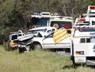Emergency services officers attend a crash near Springfield Lakes on Wednesday in which a woman driver was killed.