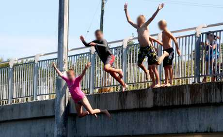 Children jump from Cudgen Creek Bridge, Kingscliff.