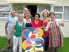 Visiting artists join local artists to add colour to the seaside village of Urunga.