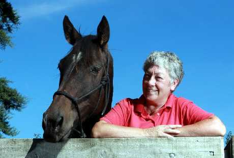 SILENT THERAPIST: Leg Up Trust's Ros Rowe with Danny Boy, a neglected horse she bought. PHOTO/FILE A - HBT111476-01