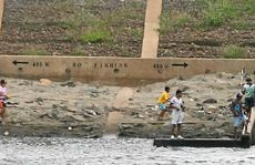 Youths ignore the signs and fish illegally at the barrage. It will cost $45,000 to fence them out.