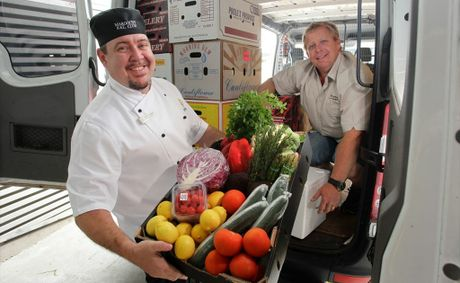 Maroochy RSL Executive Chef Brett McRae accepts some fresh produce from Lee Belcher of Platinum Produce.