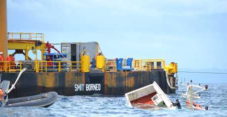 Sea conditions did not allow the barge Smit Borneo close enough to the wreck to transfer the containers by crane.