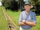 Frank Mueller, a Clarke St Bargara resident, is disgusted by the flow of effluent from the drain into his back yard.