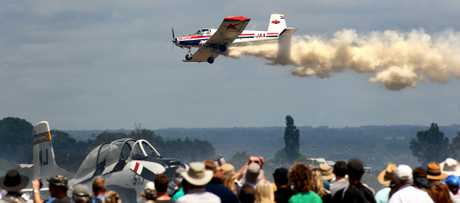 Derek Williams flies his Lycoming 400 HP Piston Engine.1.1 tonne fertiliser and spray payload plane over the crowd at the Classic of the Sky Tauranga City Airshow at the Tauranga Airport.