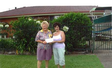 MARLENE Leggo of Coraki receiving one of the five prizes in the Country Energy Coraki Lions Club Christmas Lights random draw from Norma Thomas of the Coraki Lions Club. Photo Contributed