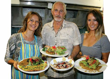 MADE WITH LOVE: Showing off some of the delicious 100% organic dishes at The Conscious Cafe in Byron Bay are owner Elisha Yarrington (right) with her dad Allan and sister-in-law Anya.