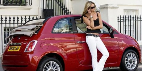 Supermodel Elle MacPherson with a Fiat 500C in London.
