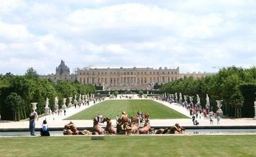Apollo Fountain - with no water - in the foreground, with the Palace of Versailles in the distance.