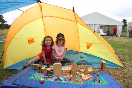 Stevie Newton, 3, and Lucie Locke, 4, have a bit of fun in the tent.