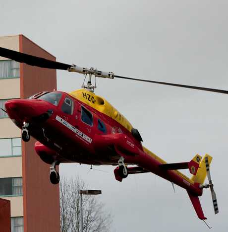 A man was airlifted to hospital after falling from a ladder.