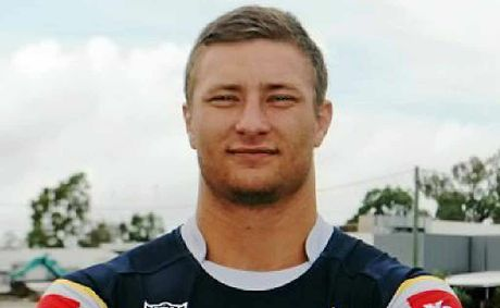 Tariq Sims models the new members' jersey.