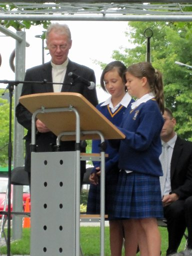 PRAYER: Reverend Graeme Pilgrim, left, accompanied by St Matthew's School students Brittney Fyfe, 11, and Lucy Youngquest, 12.