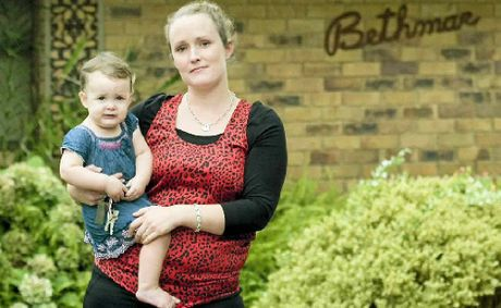 Toowoomba home owner Hannah Fowkes, with her daughter Ava, is disappointed and will have no choice but to keep ploughing on after the Reserve Bank decided not to cut official interest rates yesterday.