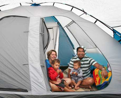 Wet weather campers Nuku and Vicki Nabete with their two children Meshach and Micah.  